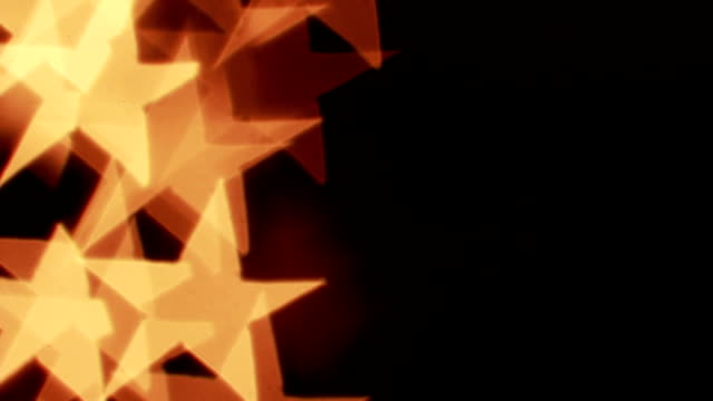 Defocused light reflections in stars shape. Loopable background video