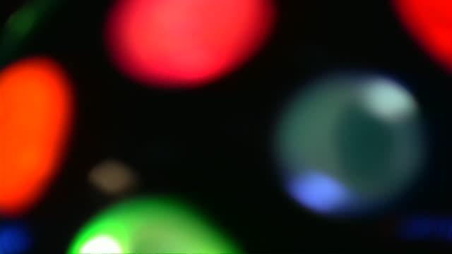 Defocused lighting equipment: disco ball, garland, decorations, running lights. video