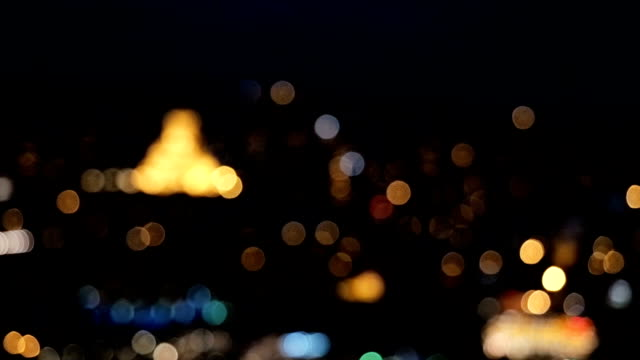 Defocused night European city view from above. The movement of cars on the road in night. Night light of old town video