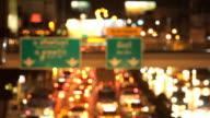 Defocused night traffic lights on road video