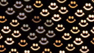Defocused smiley shaped candle lights. video