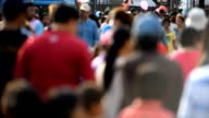 De-focused street crowd of people walk video