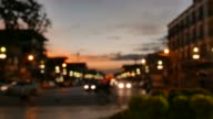 Defocused traffic and city lights on urban big street at dusk. video