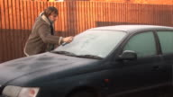 De-Icing a car on  frosty morning - HD & PAL video