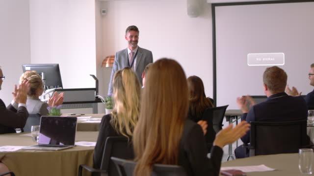 Delegates Applaud Businessman After Presentation Shot On R3D video