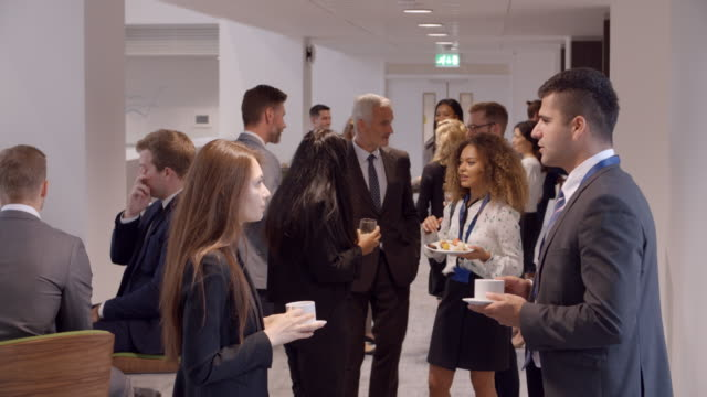 Delegates Networking During Coffee Break At Conference video