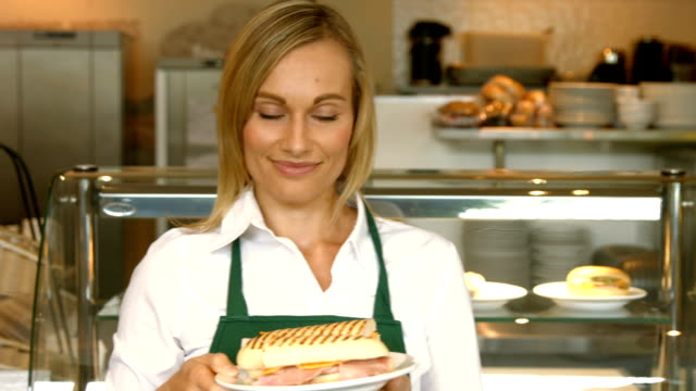 Deli worker offering a panini video