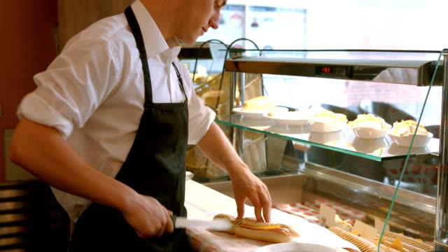 Deli worker preparing a panini video