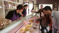 Delicatessen customers shopping video