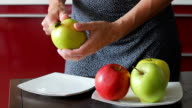 Delicious apples lay on a plate. video