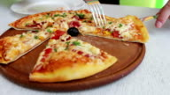 delicious baked pizza with cheese, corn, tomatoes, meat and herbs in a stylish white background, Italian cuisine video