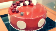 Delicious, beautiful round cake covered with sweet glaze video