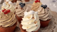 Delicious cakes with nuts and berries close up, wedding refreshments video