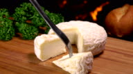 A delicious French cheese of a round shape lying on a board video