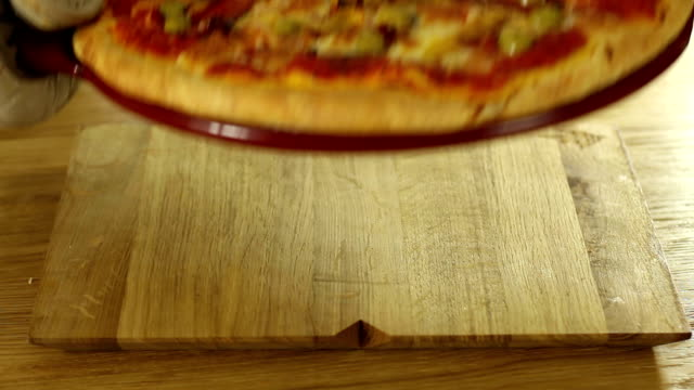 Delicious italian pizza served on wooden table video