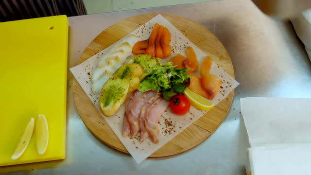 Delicious mix of meat with vegetables and toasts on wooden platter video
