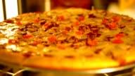 Delicious pizza rotating,selective focus, warm tone color video