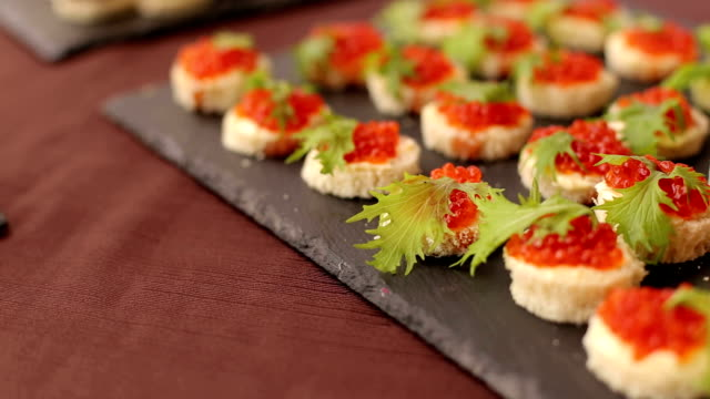 Delicious sandwiches with red caviar, close-up. video