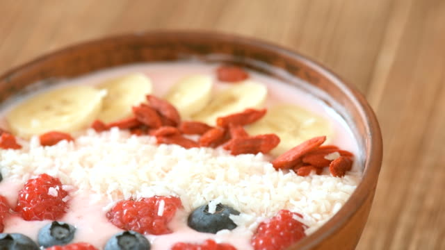 Delicious smoothie in the bowl with berries and goji video