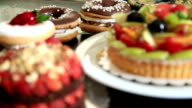 Delicious tart with fresh fruits cakes and donuts video