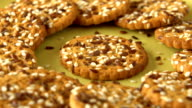 Delicious yummy freshly baked homemade cookies rotating on a green bamboo plate. Looped video