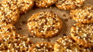 Delicious yummy freshly baked homemade cookies rotating on a sackcloth. Looped video
