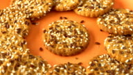 Delicious yummy freshly baked homemade cookies rotating on a orange bamboo plate. Looped video