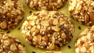 Delicious yummy freshly baked homemade oatmeal cookies rotating on a green bamboo plate. Looped video