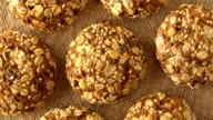 Delicious yummy freshly baked homemade oatmeal cookies rotating on a sackcloth. Looped video