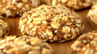 Delicious yummy freshly baked homemade oatmeal cookies rotating on a wooden board. Looped video