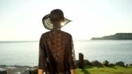SLOW MOTION: Delighted girl running towards magical sunrise above stunning ocean video
