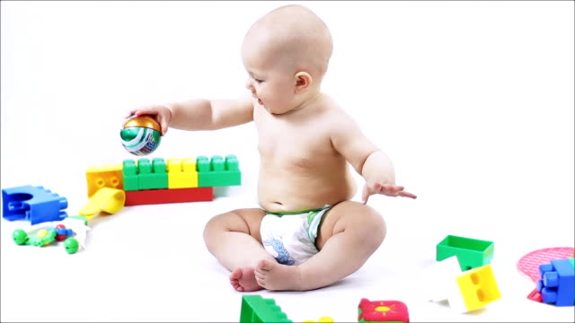 Delightful small child playing with toys. video