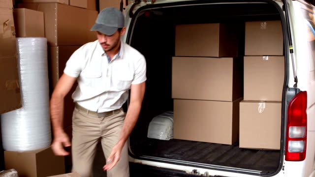 Delivery driver loading his van video