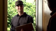 Delivery man delivering package to a home video
