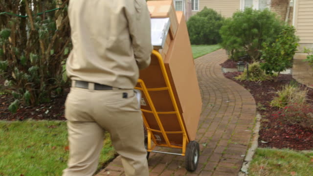 Delivery man delivers packages to home video
