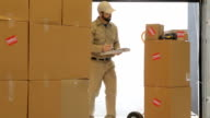 Delivery man in shipping warehouse video