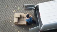 Delivery Man Loads his Commercial Van with Cardboard Boxes. Speed up Video. video