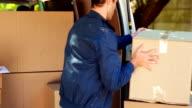 Delivery man unloading his van video