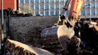 Demolition grabber in front of office block video