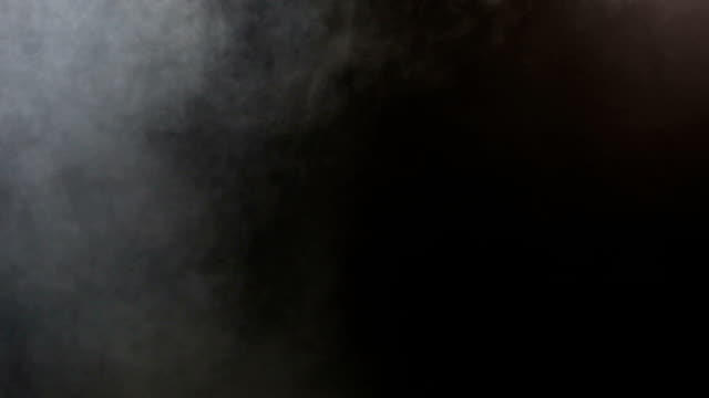 Dense Fluffy Puffs of White Smoke and Fog on Black Background, Abstract Smoke Cloud video