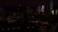 AERIAL: Dense traffic on Brooklyn Bridge interchange overpass underpass at night video