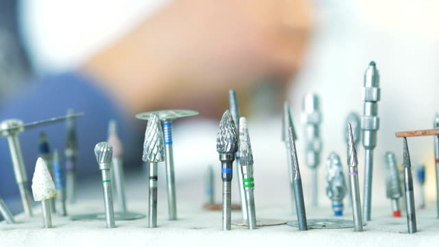 Dental instruments on background of dentist making model of jaw video