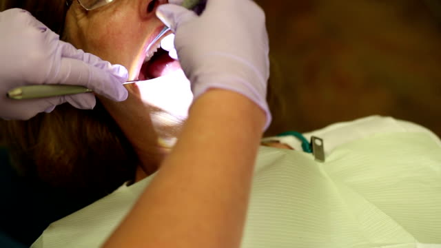 Dental Patient Receiving Teeth Cleaning from Above video