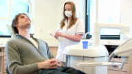 Dental prepare handgloves with patient lying waiting video