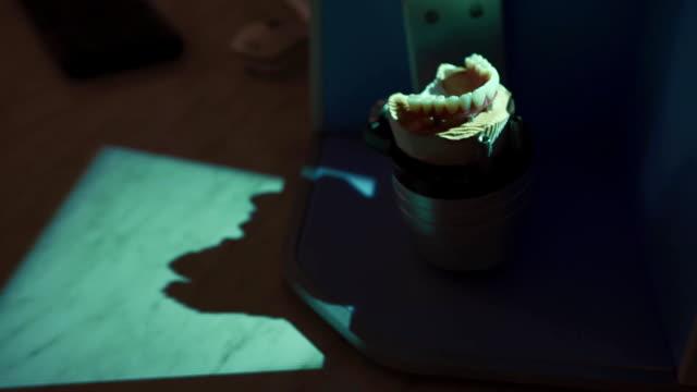 Dental prosthetic restoration. Denturist creating 3D model for sculpted denture with high tech equipment video