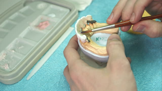 Dental technician making teeth implant video