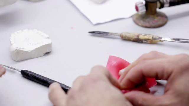 Dental technician working on a jaw model video