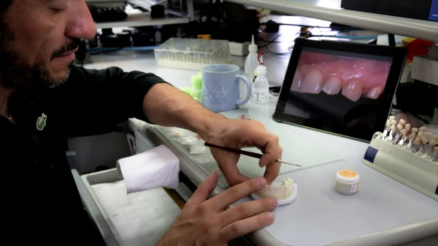 Dental technician working on prosthesis video
