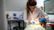 Dentist curing a female patient video