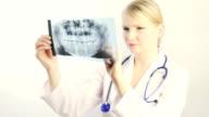 Dentist examining X-Ray image video